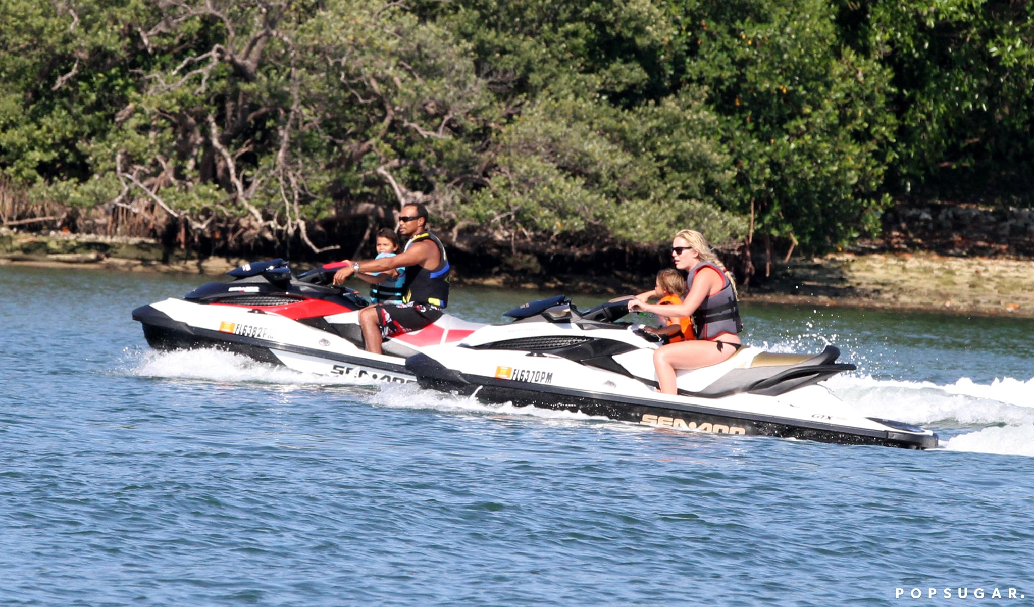 Lindsey Vonn and Tiger Woods took his kids, Sam and Charlie, for a ride on water skis in Palm Beach.