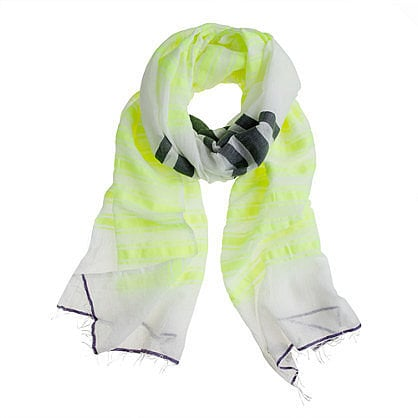 A lightweight scarf is ideal for throwing over pretty much everything — we love this Lemlem Ishi Gauze Scarf ($140).