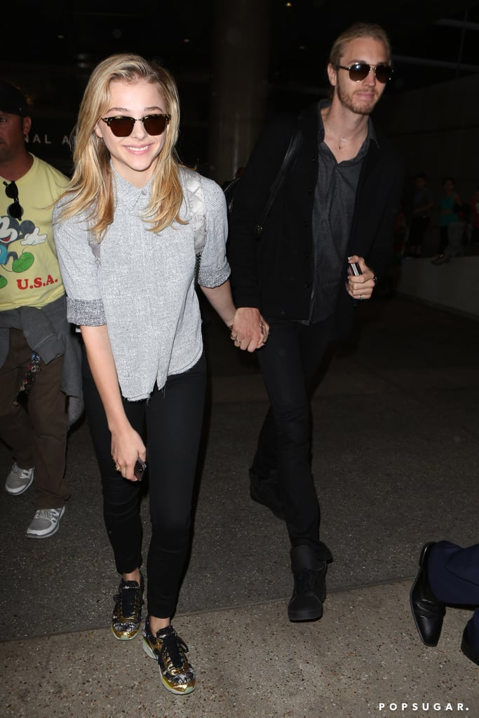 Chloë Moretz held hands with her brother Trevor at LAX on Thursday.