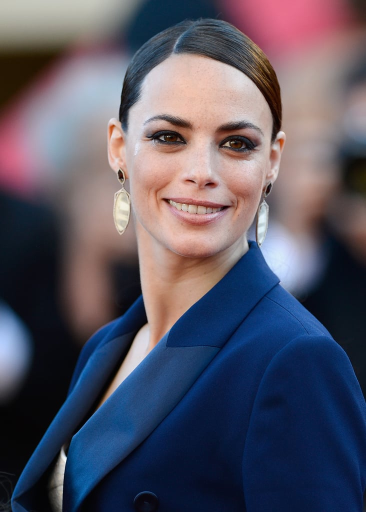 A sleeker look for Berenice Bejo here — her hair's kept firmly out of the way so her darkly-rimmed eyes can shine.