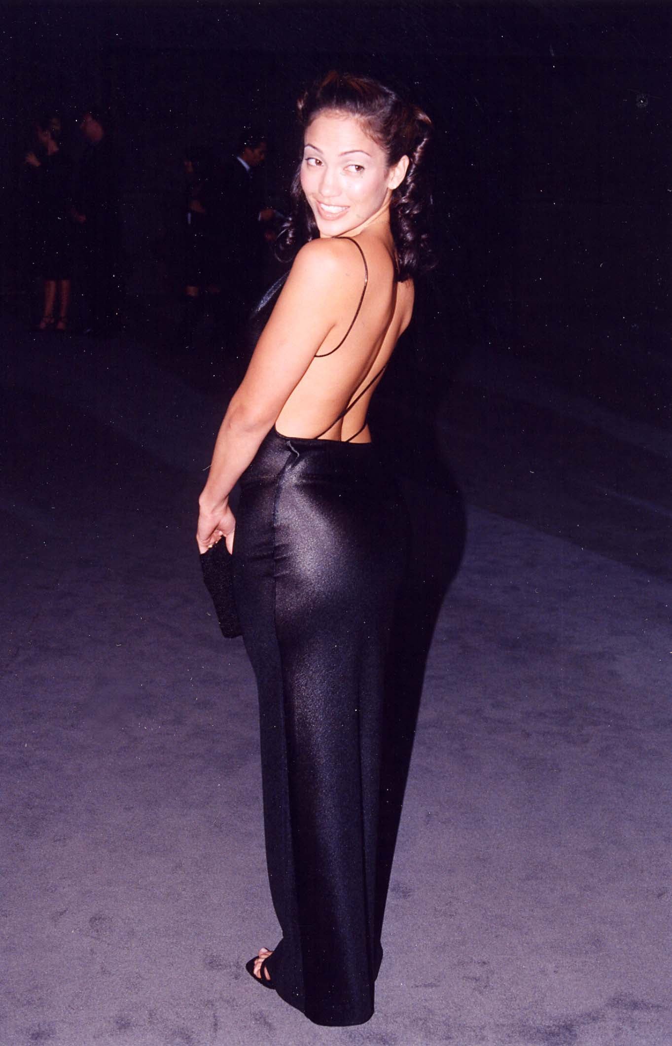 Showing off her assets in black at a '97 event.