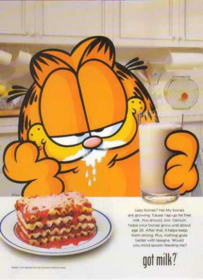 Apparently Garfield likes to wash his lasagna down with a tall glass of milk.