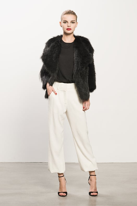 Coyote Black Fur Coat ($2,295) Cashmere Black Tee ($295), Crepe Cream Elastic Botton Pant ($595), Whisper Black Suede Sandal ($595) Photo courtesy of Tamara Mellon