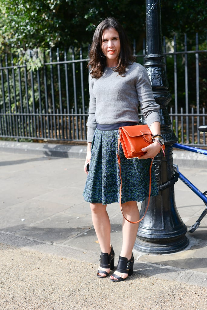 All you need is a brightly hued statement bag to make an outfit.