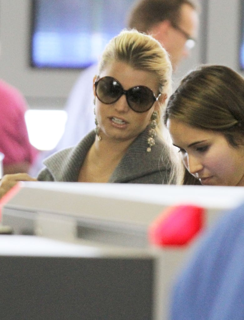 Jessica Simpson wore dark sunglasses at LAX.