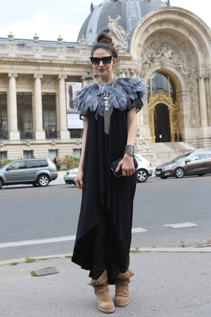 A feathered collar glammed up her dress while a pair of studded biker boots dressed it down.