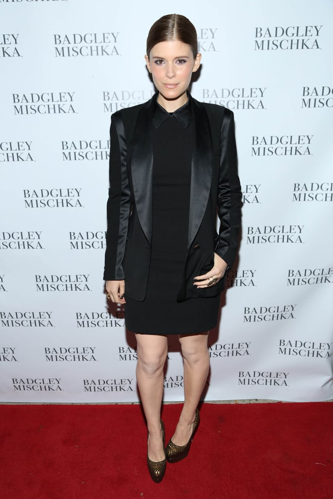 Also at the Badgley Mischka store opening, Kate Mara stuck to a menswear vibe in a silky tuxedo jacket and a black collared dress.