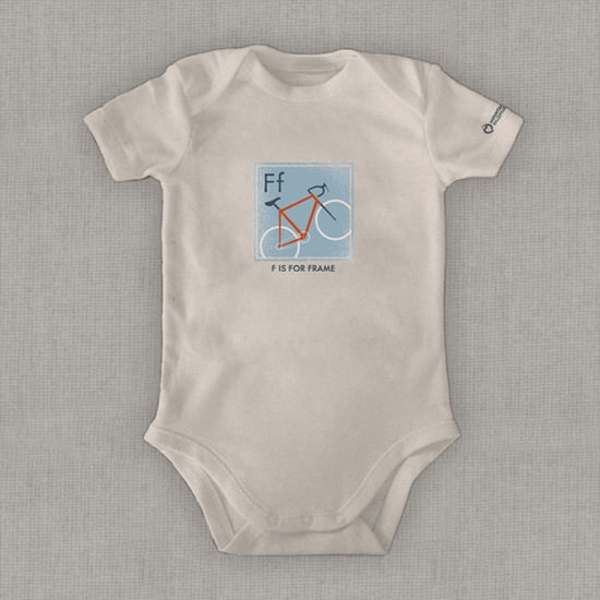 """Hip biker parents can now teach their kids the alphabet through cycling jargon. """"F Is For Frame"""" Organic Onesie ($29) gears them up in the right direction. The clothing company also donates 10 percent of the proceeds to Children & Nature Network, an organization that promotes outdoor education."""