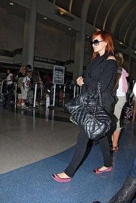 Mama-to-Be Ashlee Simpson-Wentz Takes Flight