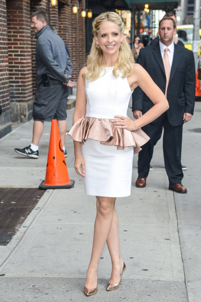 Sarah Michelle Gellar waltzed back into our fashion consciousness in a rather adorable white-and-blush peplum dress. She finished it off with an equally sweet pair of rose-gold Stuart Weitzman heels.