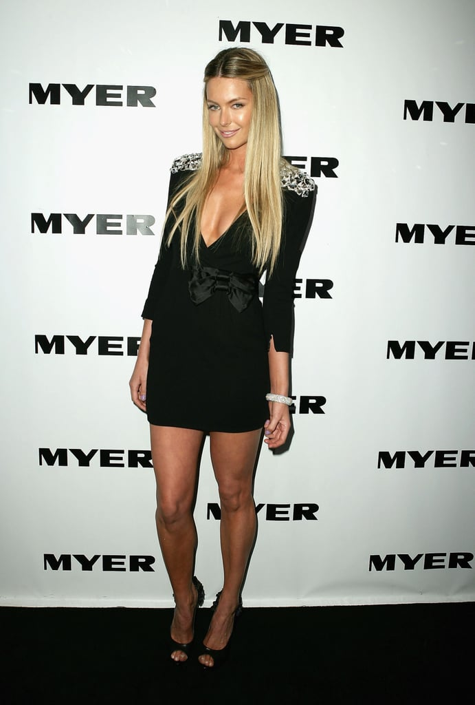 Long straight hair and a black mini was Jen's look at a Myer collection launch in Aug. 2009.