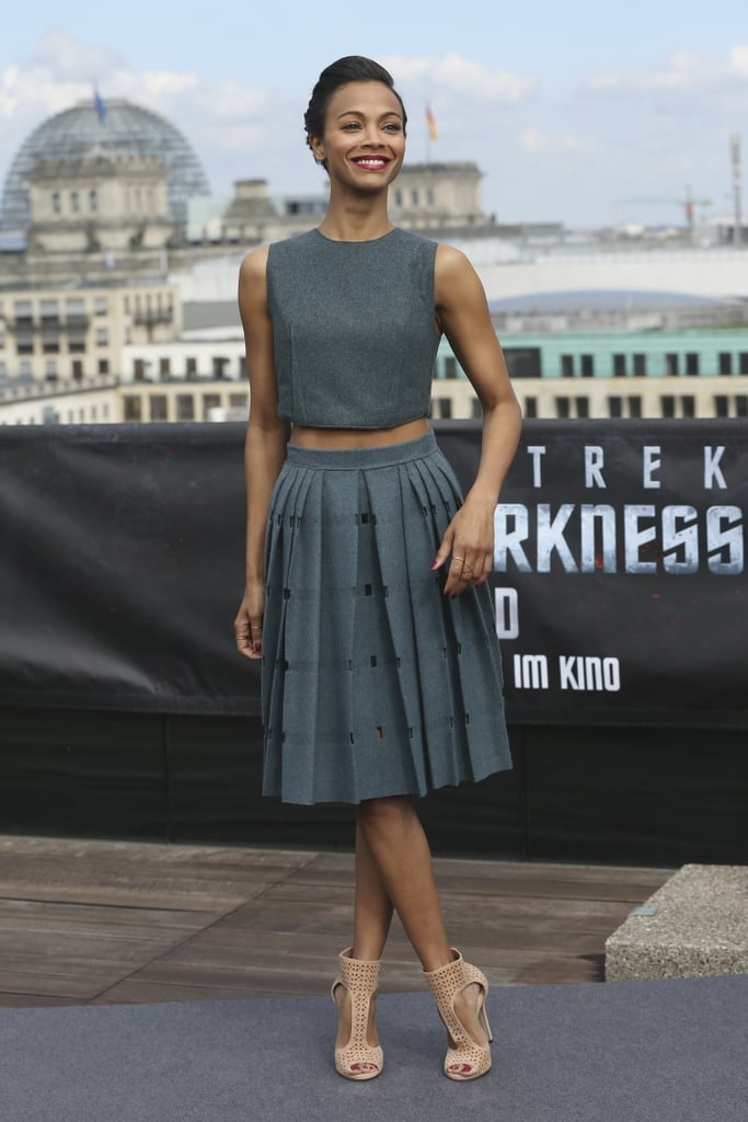 Want to transition into Fall with a crop top? Zoe Saldana's Calvin Klein dark gray wool look can do just that.
