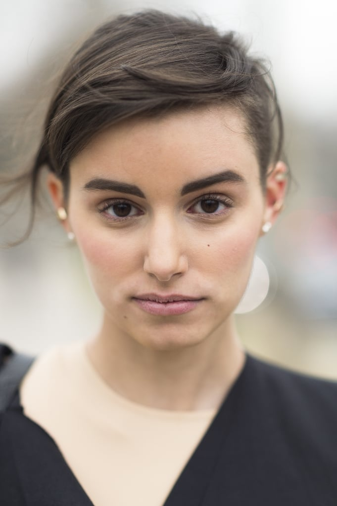 This windswept style with bold brows was your favorite among all the Parisian street-style looks. This fashionista just has that je ne sais quoi.
