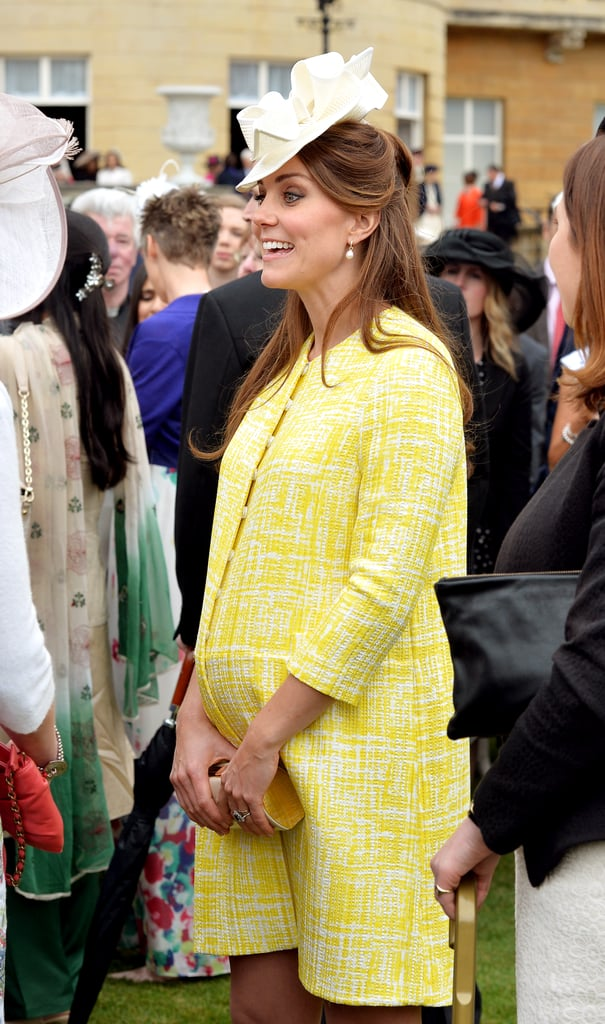 Pregnant Kate Middleton wore a yellow coat by Emilia Wickstead to attend Queen Elizabeth's annual garden party in London.