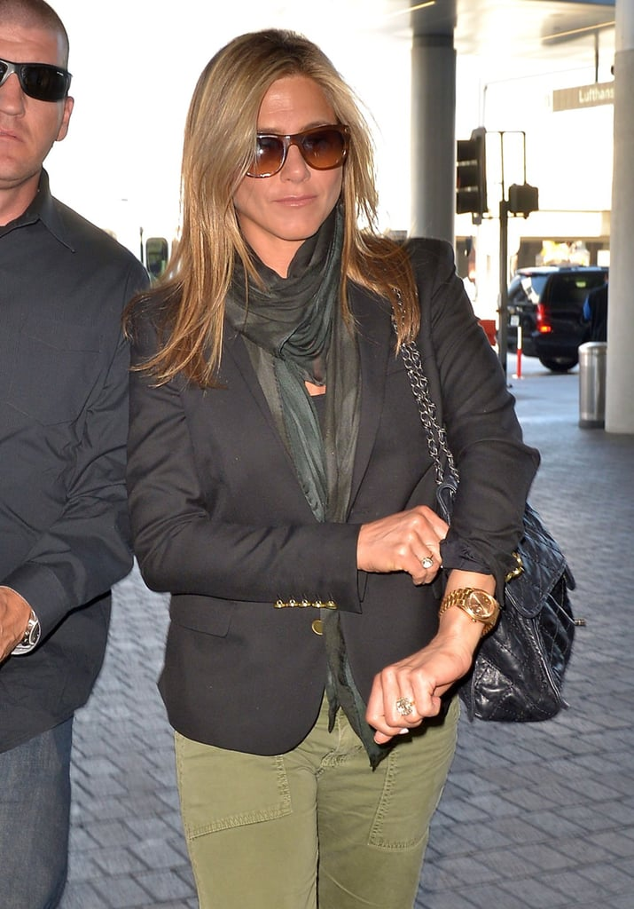 Jennifer Aniston showed off her engagement ring as she made her way through the airport.