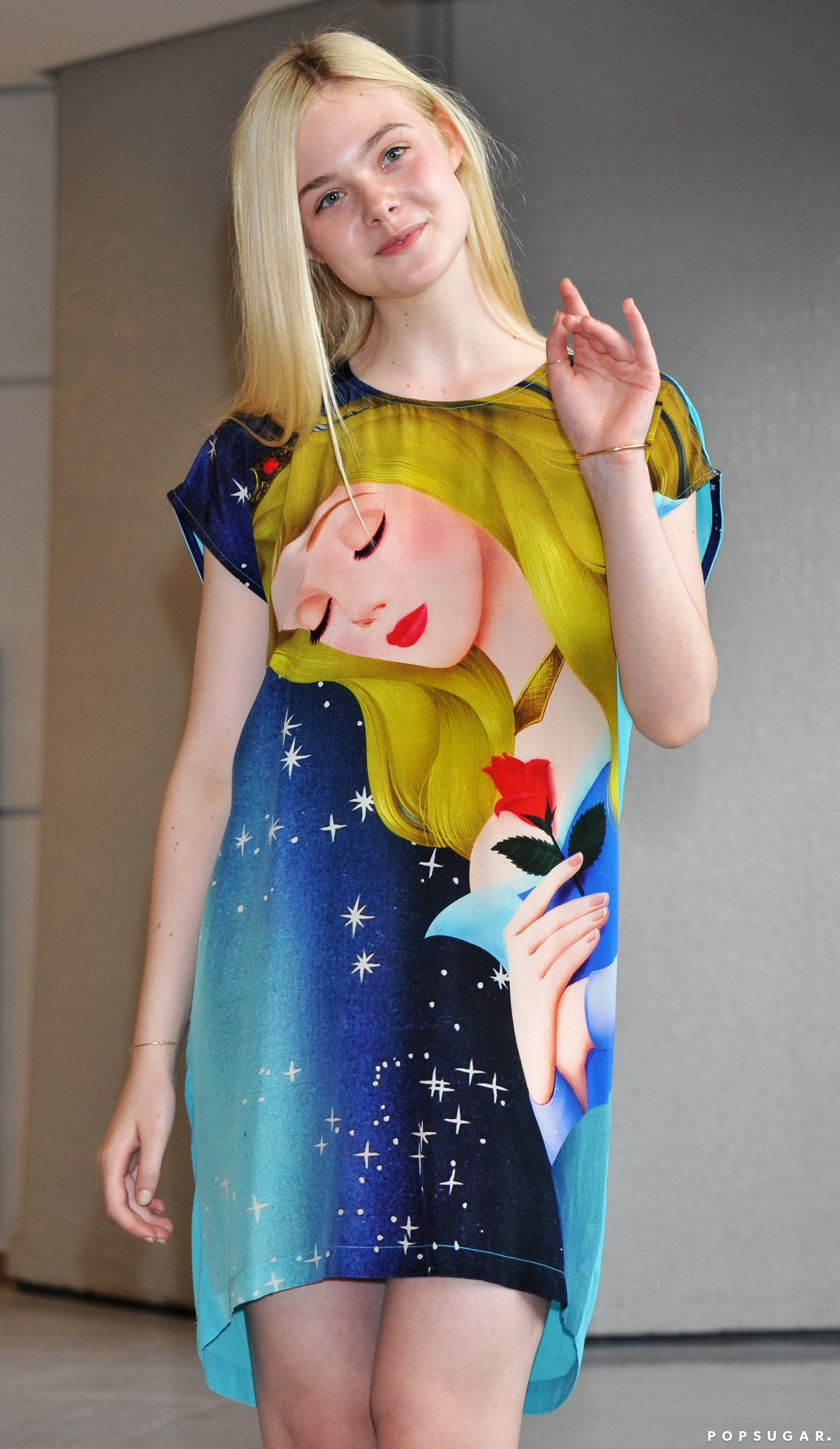 Elle Fanning made her arrival in Tokyo in a Sleeping Beauty dress on Saturday.