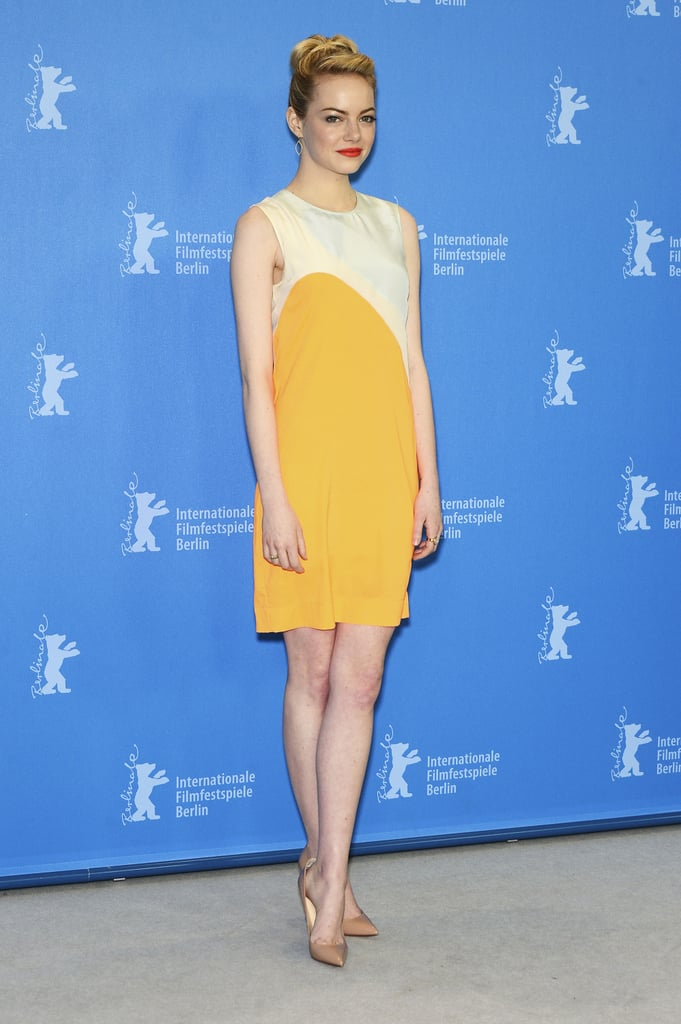 Emma Stone punched up her style in a colorblocked orange Stella McCartney dress and Jamie Wolf earrings at The Croods photocall in Berlin.