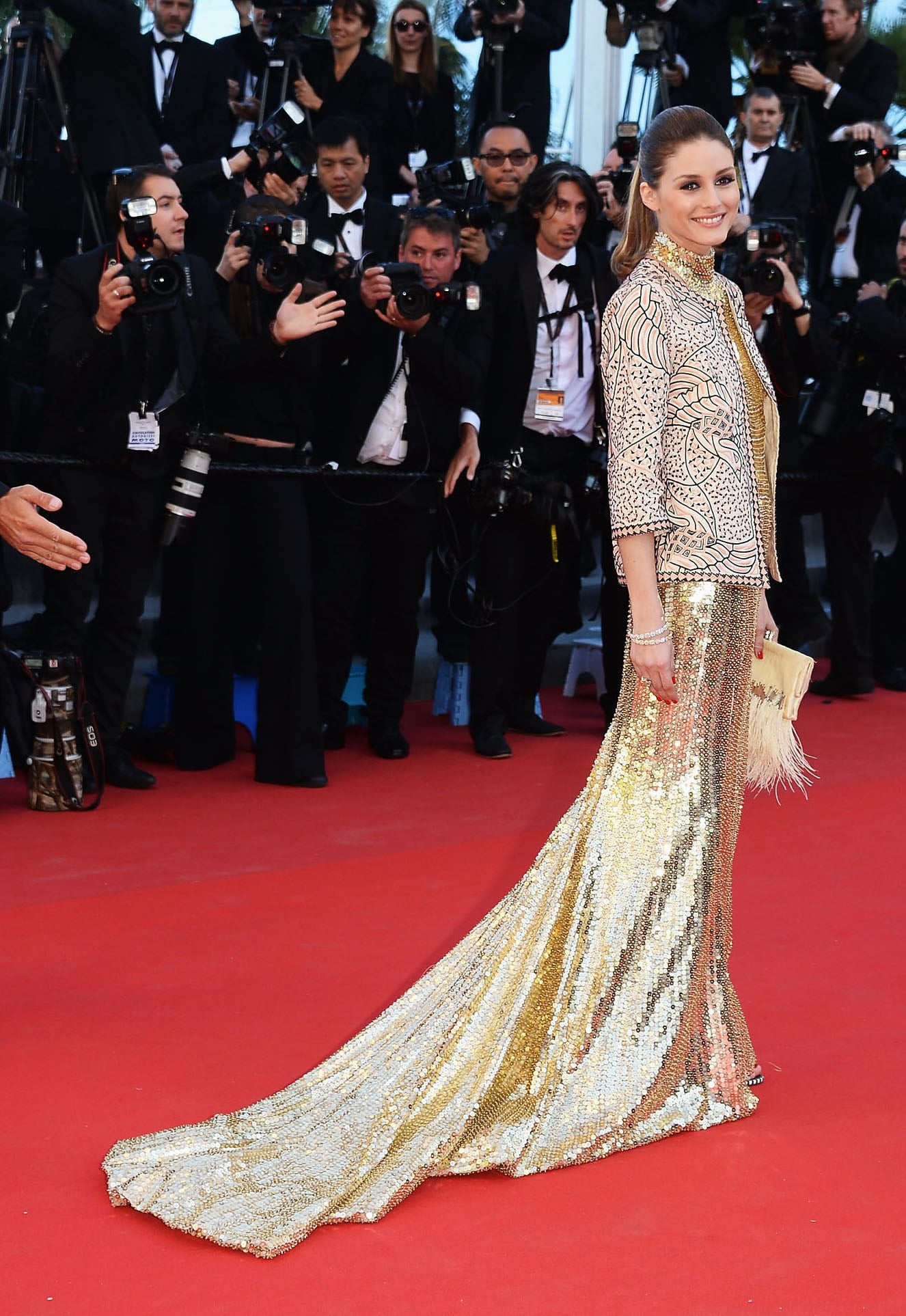 Proving she really is a style golden girl, Olivia Palermo went full-carat-ahead in a long Roberto Cavalli gown and jacket for the 2013 Immigrant premiere.