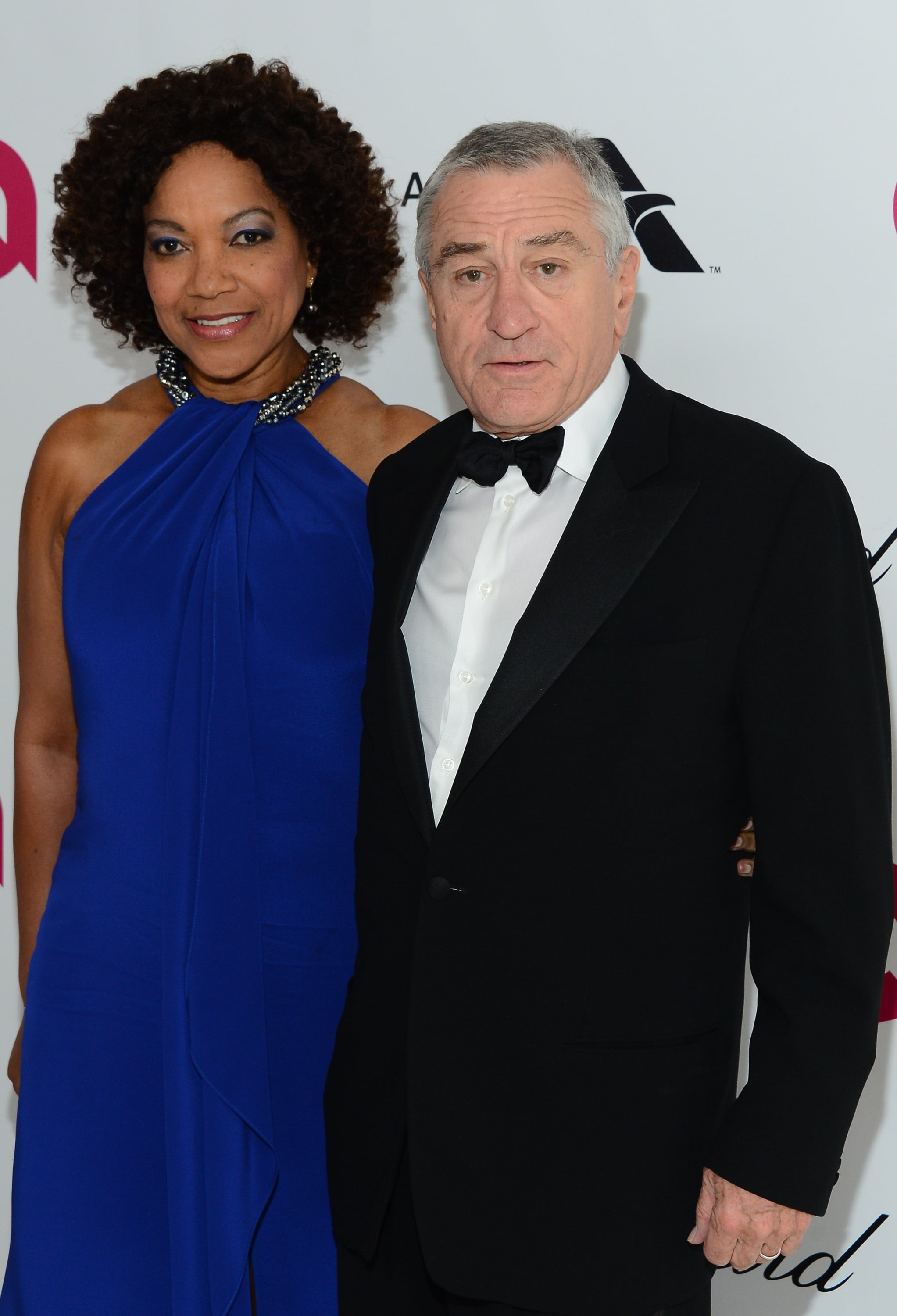 Robert De Niro and his wife, Grace Hightower, smiled ...