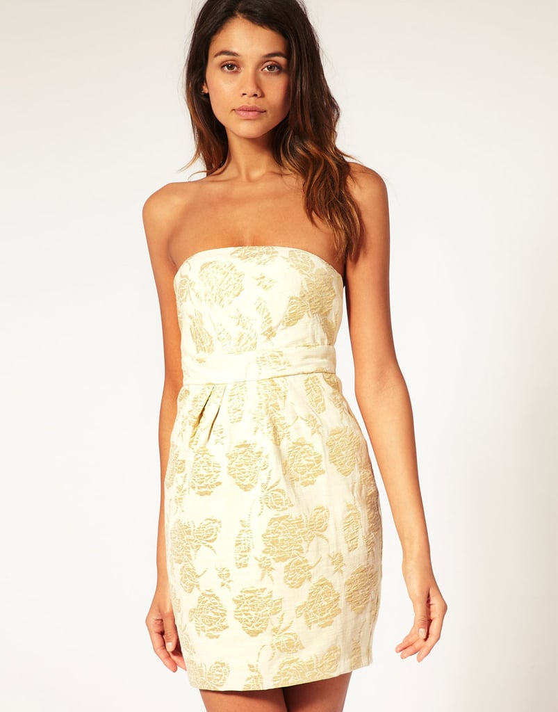 The gold jacquard feels luxe and festively chic.  ASOS Cocktail Dress in Gold Jacquard (approx $46)