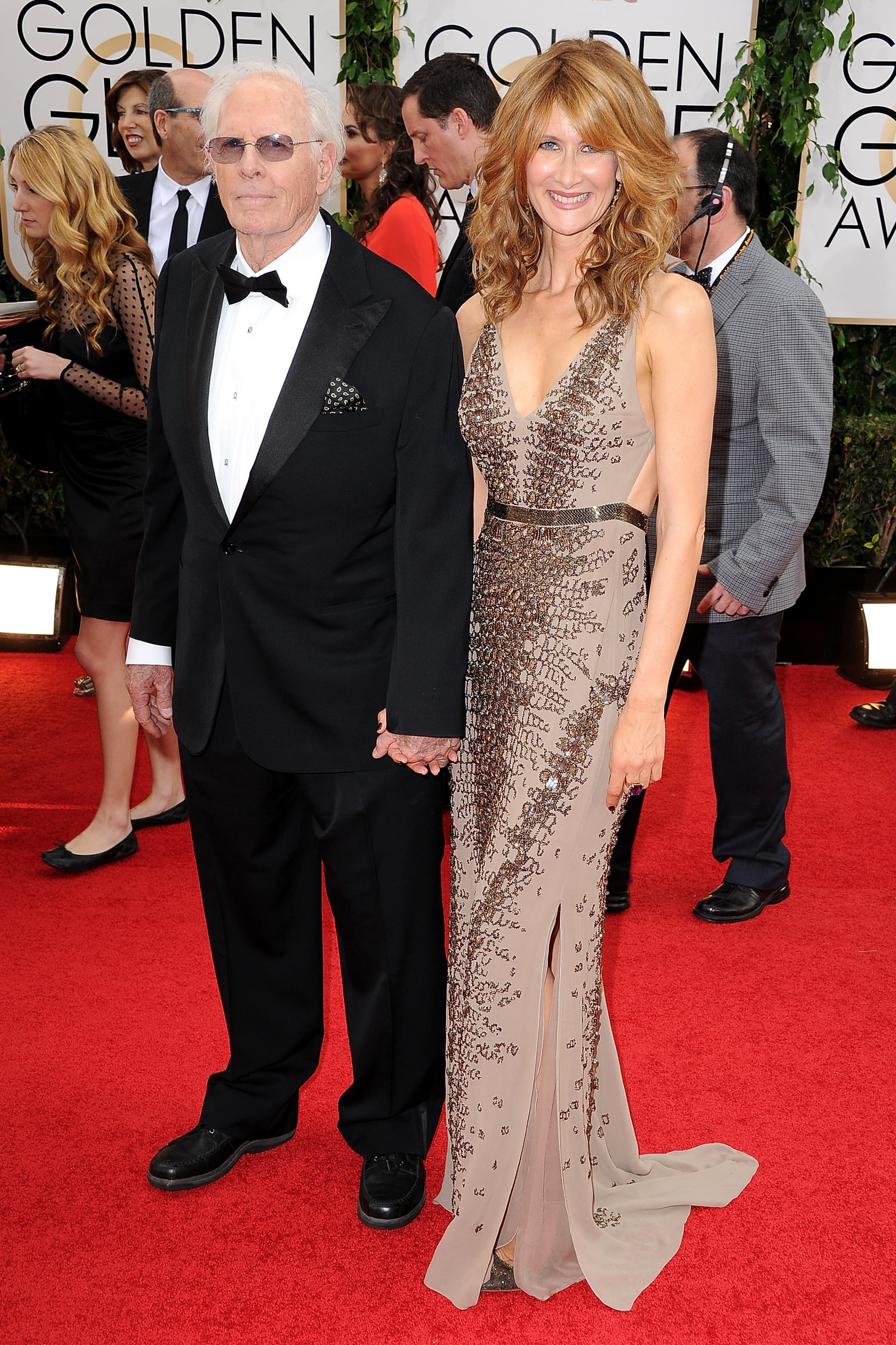 Laura Dern not only arrived at the Golden Globes alongside her father, Bruce, but she also hit the stage to present his nominated film, Nebraska.