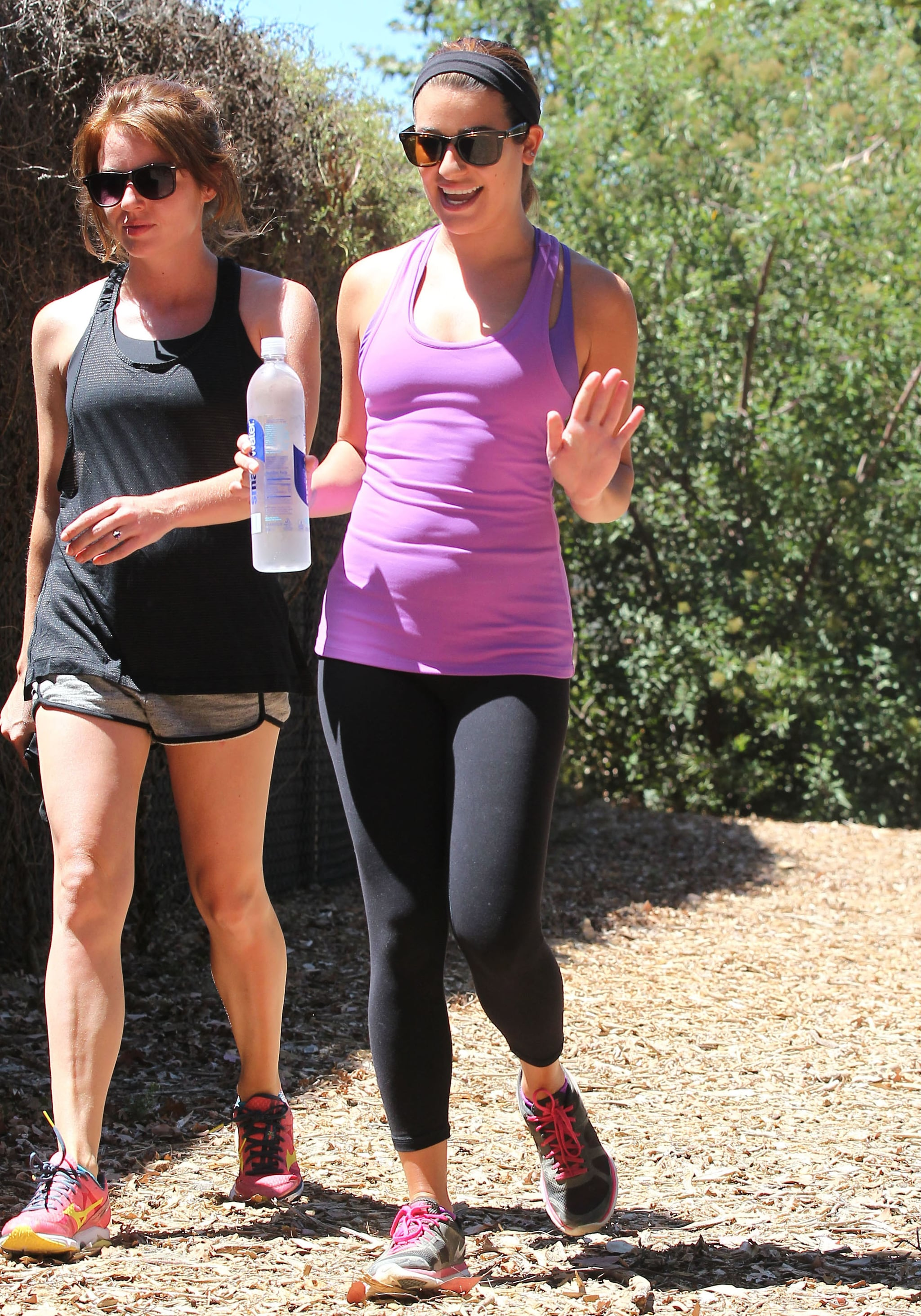 Lea Michele flashed a smile while hiking in LA with a girlfriend on Sunday.