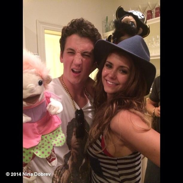 Nina shared this photo on Instagram, so she's dating either Divergent's Miles Teller or one of those two puppets.