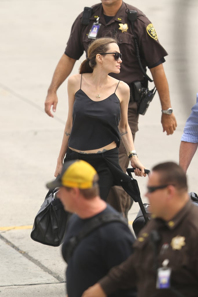Angelina Jolie wore black to board a plane in Hawaii to return to LA.