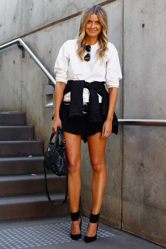 Black and white never looked so cool (and just a little sexy) with a thigh-high hemline and ankle-cuff heels.