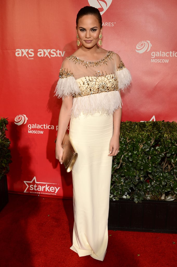 Chrissy Teigen's feathery embellished gown at the MusiCares event in LA was simply stunning.