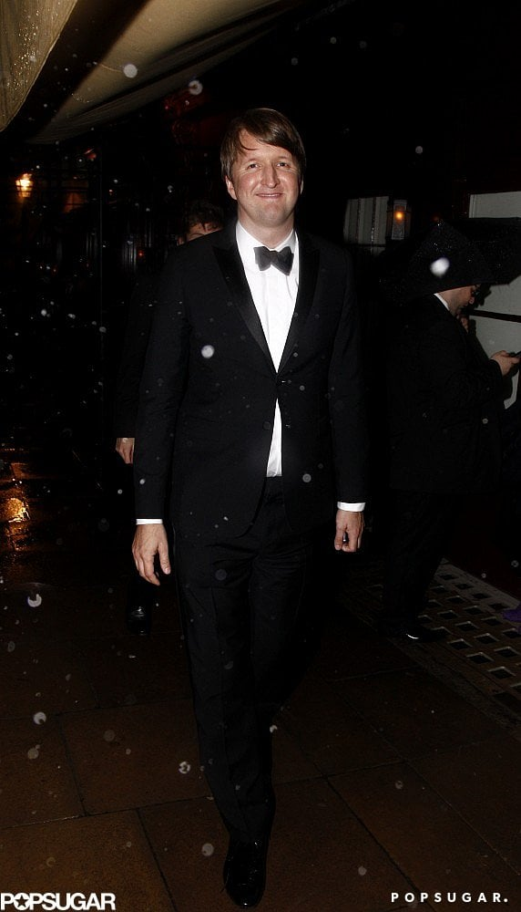 Tom Hooper smiled on his way to a BAFTA Awards afterparty.