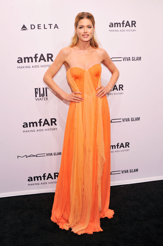 Doutzen Kroes looked beautiful in orange when she attended the amfAR Gala on Wednesday.