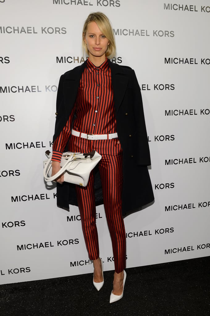 Karolina Kurkova showed off a sharp striped Michael Kors getup with fresh white pointy-toe pumps at the designer's Fall 2013 show in New York.