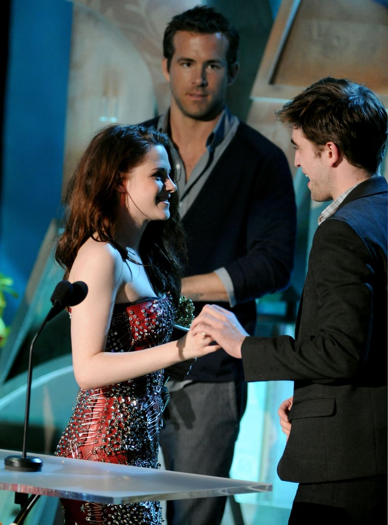 """While Ryan Reynolds was busy promoting his 2009 film Adventureland, which he starred in with Kristen Stewart, one interviewer asked if he was a Twilight fan. That's when Ryan revealed his secret crush on Robert Pattinson:  """"Are you kidding me? Robert Pattinson? In a word? Dreamy . . . I'm not gay, but I'm thinkin' about it."""""""