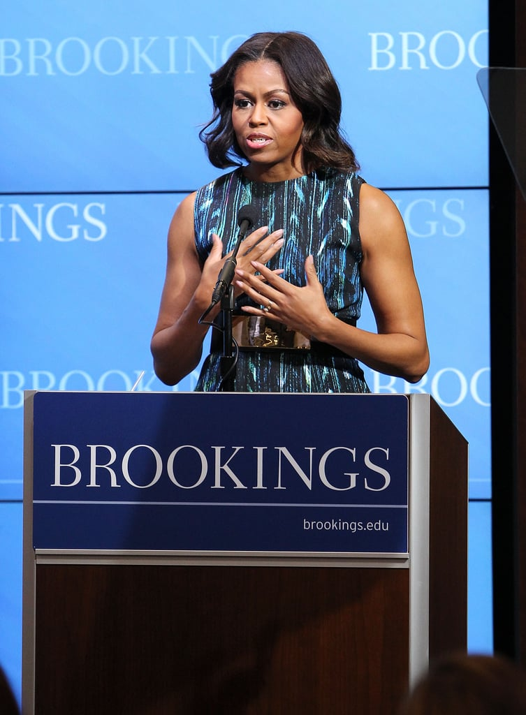 Michelle opted for a graphic print tank dress and smartly cinched her waist with a gold plated belt when she spoke at the Mobilizing for Children's Rights event.