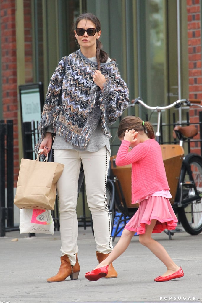 Suri Cruise had an animated phone conversation while she was out with Katie Holmes.