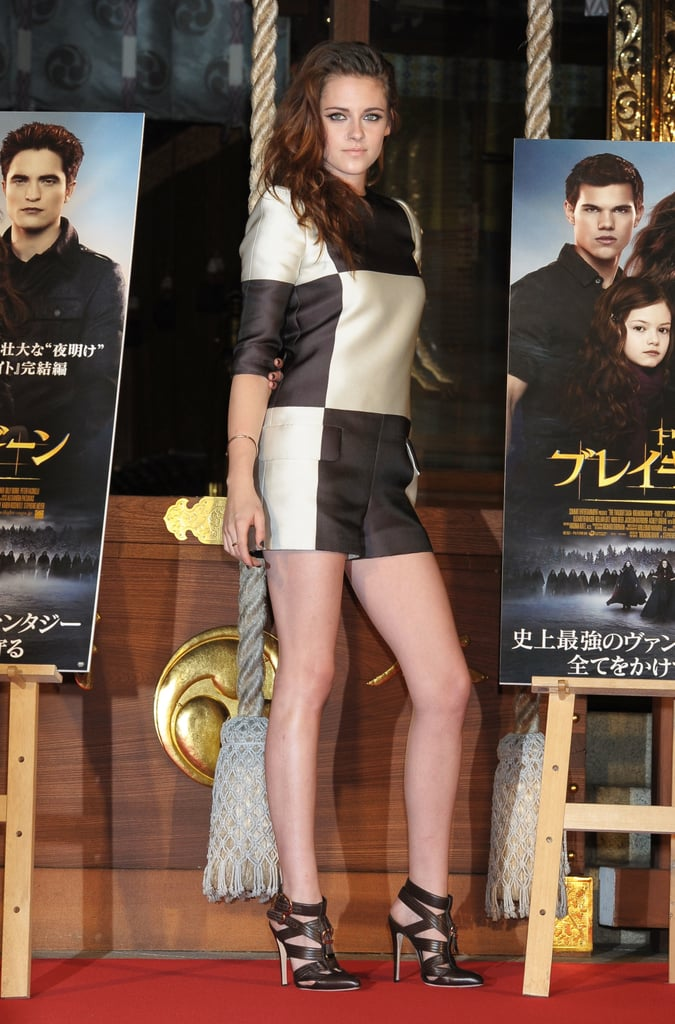 Kristen Stewart showed off her gams in Louis Vuitton's checkered romper at a The Twilight Saga: Breaking Dawn Part 2 press event in Tokyo.