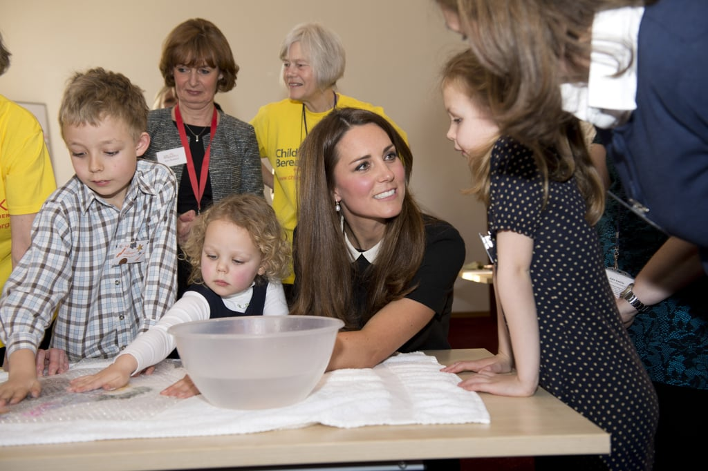 Kate listened intently to a little girl as she visited the offices of Child Bereavement UK in March.