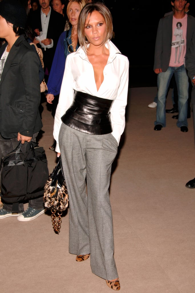 At the Marc Jacobs February 2007 show, Victoria Beckham showed off her waistline in a tight white blouse with a leather accent.