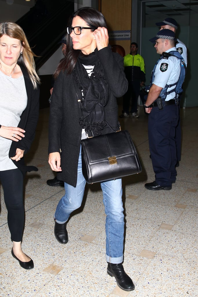 Smells like Aussie spirit! Landing at Sydney airport on Monday, eagle-eyed fans noticed that Sandra was wearing the Bamboo striped tank and Lana coat (it's on sale, you guys), both by homegrown label Bec & Bridge. Love her structured bag and cuffed jeans, too.