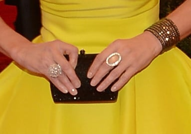 Joely Richardson wore silver- and gold-toned jewelry and carried a black clutch.