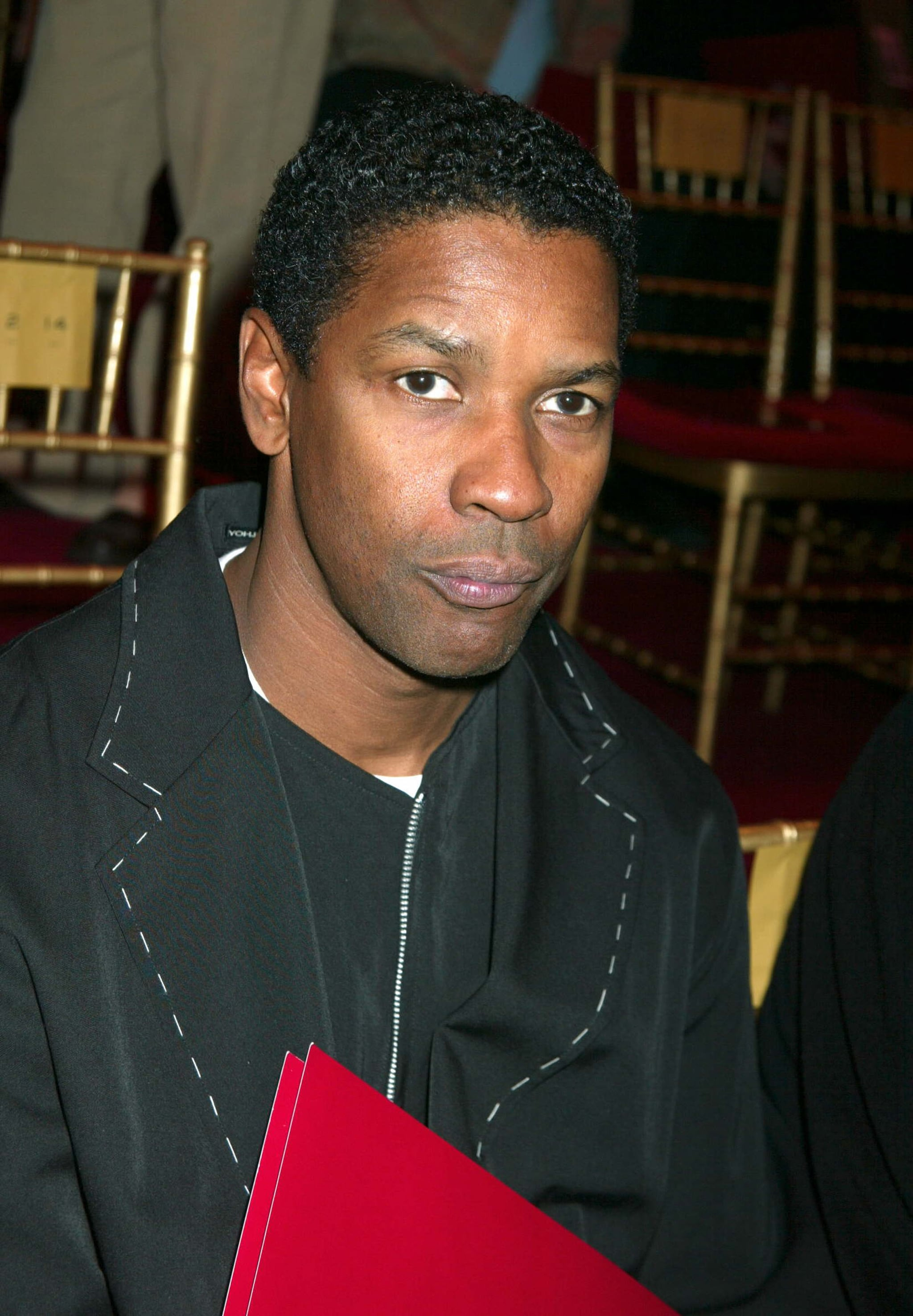 Denzel Washington sat happily in the front row in 2003.