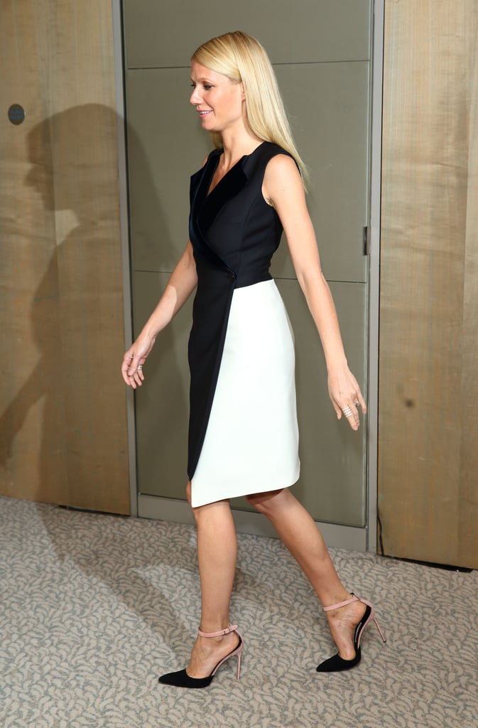 At the London photocall of Iron Man 3, Gwyneth Paltrow chose another two-toned Dior dress (in her favorite black and white color scheme), and paired the look with sleek straight hair and complementing two-toned ankle-strap pumps.