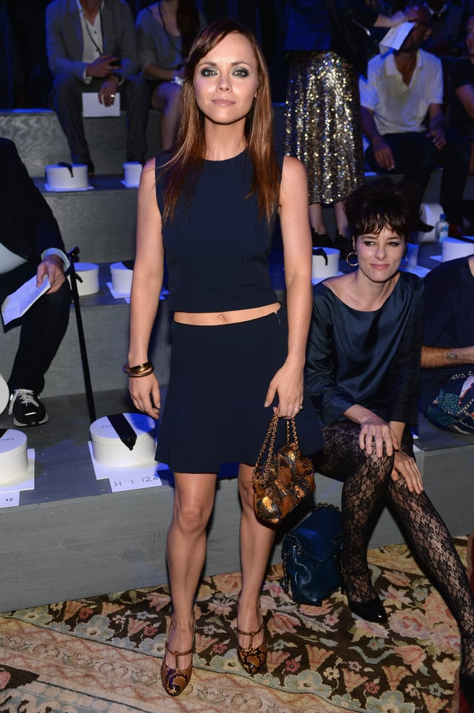 Christina Ricci did the crop in a navy look at the Marc Jacobs show. She finished with luxe snakeskin add-ons.