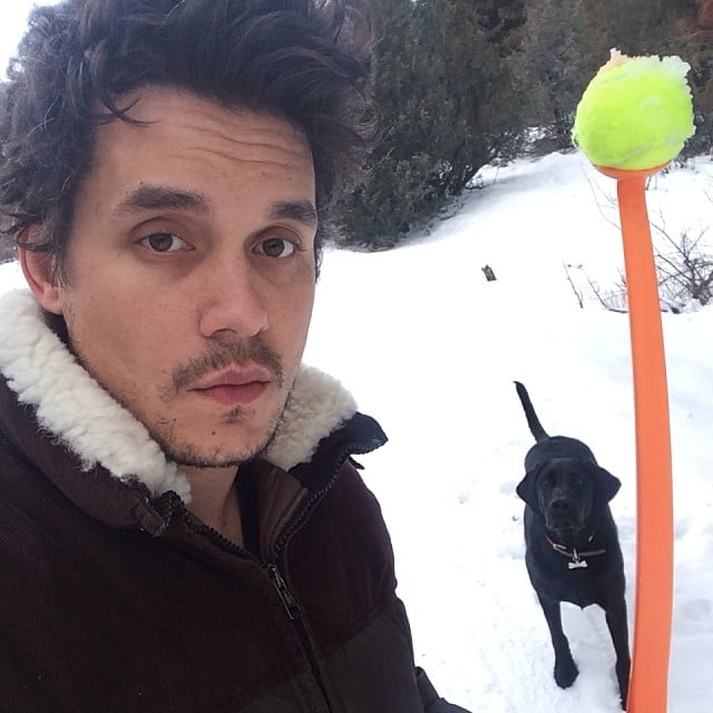 John Mayer played fetch with his dog in the snow. Source: Instagram user johnmayer