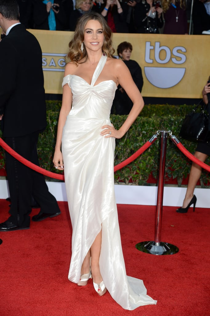 Sofia Vergara had a goddess moment in a white liquid lame Donna Karan Atelier gown with Charlotte Olympia peep-toes and a Jimmy Choo bag.