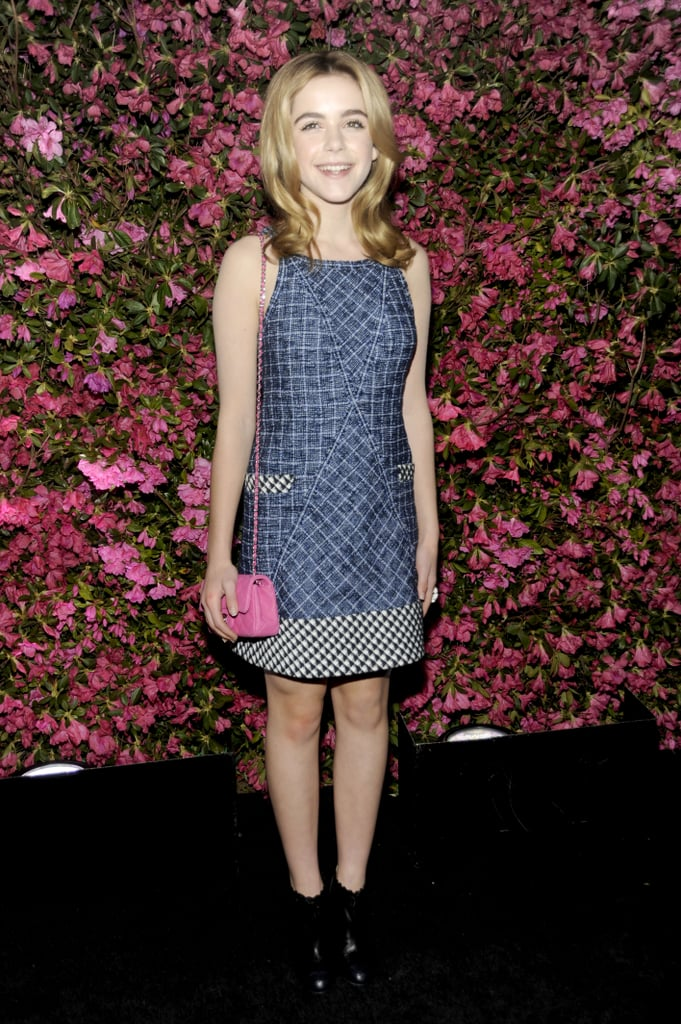 Kiernan Shipka was age-appropriate in a Chanel denim dress and an adorable pink Chanel bag.