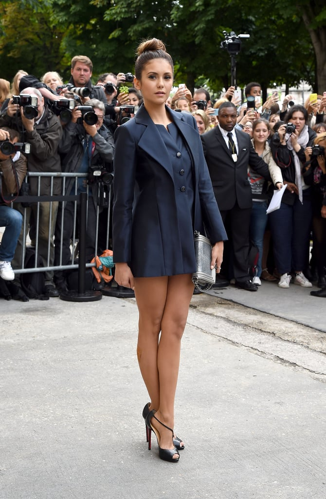 Nina stepped out in a structured navy look the the Chanel show during Paris Haute Couture Fashion Week for Fall 2014.