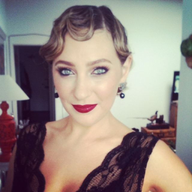 Amazing Face author Zoe Foster opted for a 1920s curled 'do and bold red lip. Twitter User: KateSquires