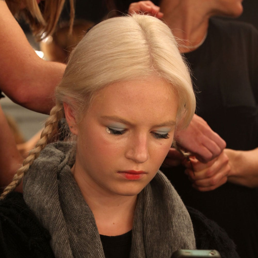 Models' hair was sectioned into two low-slung pigtails and braided.